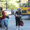 TIM JEAN/Staff photo<br /> <br /> Mary Hill, Principal Grinnell Elementary School gestures to a student as she gets off the bus on the first day of school in Derry, NH.   8/31/20