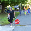 TIM JEAN/Staff photo<br /> <br /> Mary Hill, Principal Grinnell Elementary School walks with a student as they get off busses on the first day of school in Derry, NH.   8/31/20