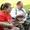 CARL RUSSO/Staff photo Elysia Desjardins, 19 and her father Ron. They live in Derry. Derry Public Library hosted an outdoor ukulele program Wednesday night outside the library. 8/05/2020