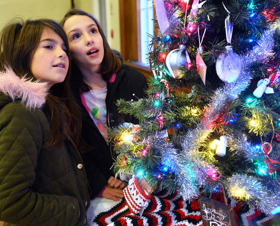 CARL RUSSO/Staff photo. Friends, Megan Dolan,10 and Abigail Stienecker, 9, both of Derry take a close look at one of the trees. The Annual Festival of Trees at Upper Village Hall was held Saturday to support Upper Room family resource center in Derry. 12/15/2018