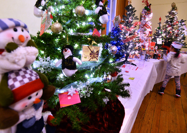CARL RUSSO/Staff photo. The Annual Festival of Trees at Upper Village Hall was held Saturday to support Upper Room family resource center in Derry. 12/15/2018