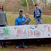 TIM JEAN/Staff photo<br /> <br /> Triathlon competitor Omar Brahim, who was unable to compete in races because Covid-19 canceled them, made his own course around Windham. Brahim wanted to complete the race locally to show his young boys that hard work even in hard times pays off. Pictured with his wife Jen and their children Malik, 5, Tarek, 3, and Zayn, 15 months old outside their Windham home.   12/1/20