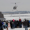 TIM JEAN/Staff photo<br /> <br /> Santa Claus waves as he arrives by helicopter at the Aviation Museum of New Hampshire for an outdoor event Saturday morning. The museum is located in the historic 1937 airport terminal at the Manchester-Boston Regional Airport.   12/12/20