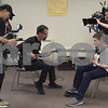 "TIM JEAN/Staff photo <br /> <br /> Godsmack guitar player Tony Rombola, center, works with  Hood Middle School student James MacDonald, right, as they learn part of a song before filming a video for  ""Unforgettable.""      2/14/20"