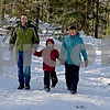 TIM JEAN/Staff photo <br /> <br /> The Webber family of Londonderry, from left, Jerrid, Liam, 7, and Gabriela hold hands as they walk down a small hill along the Landing Trail during the Annual Musquash Field Day in Londonderry, NH.  2/15/20