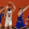CARL RUSSO/staff photo Pinkerton's senior basketball captain Jimmy Flynn in action against Londonderry. 2/10/2021