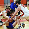CARL RUSSO/staff photo Pinkerton captains Andy MacDonald, left and Jimmy Flynn fight for the ball with Londonderry's Zack Furlong. Londonderry at Pinkerton boys basketball. 2/10/2021