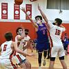 CARL RUSSO/staff photo Londonderry's Brian Gould sails to the hoop surrounded by Pinkerton defenders including Aidan Kane, left and Quinn Hammer, right. Londonderry at Pinkerton boys basketball. 2/10/2021