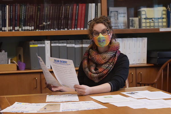 TIM JEAN/Staff photo<br /> <br /> Derry Public Library Teen Librarian Erin Robinson sorts out some submissions for a pandemic diaries project. The library project will consist of residents letters, artwork, worksheets by students as well as local history experts.     1/2/21