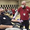 TIM JEAN/Staff photo<br /> <br /> Paul Moran, left, of Derry, is prepared to give blood by Brad Beauchamp, a Collection Technician for the Red Cross during the Derry police annual winter blood drive held at the Calvary Bible Church in Derry, NH.  1/15/21