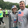 JULIE HUSS/Staff photo <br /> <br /> Mark Connors and daughter Madie were among those taking part in the July 4 Run for Freedom race in Derry. Runners took off on the Derry rail trail and ran a course in the area before crossing the finish line back at the trail in downtown Derry. Connors is president of the Derry Rail Trail Alliance.