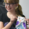 TIM JEAN/Staff photo<br /> <br /> Emelia Eporter, 10, shows of her finished owl she made in the craft area during Londonderry's Recreation Summer playground program held at South Elementary School.      7/22/21