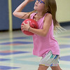 TIM JEAN/Staff photo<br /> <br /> Gabriella Rao, 6, throws a ball while playing dodgeball during Londonderry's Recreation Summer playground program held at South Elementary School.      7/22/21