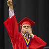 AMANDA SABGA/Staff photo<br /> <br /> Nathan Landry motions to the crowd as he crosses the stage during Pinkerton Academy's 2018 graduation ceremony at the SNHU Arena in Manchester.<br /> <br /> 6/11/18