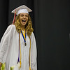 AMANDA SABGA/Staff photo<br /> <br /> Emilie Brown laughs as she crosses the stage during Pinkerton Academy's 2018 graduation ceremony at the SNHU Arena in Manchester.<br /> <br /> 6/11/18