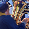 CARL RUSSO/Staff photo Windham's Leo Ducharme is reflected in his tuba as he plays with the Windham High Concert band for the last time during graduation. Windham High School's graduation ceremony was held Friday night. 6/15/2018