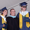 CARL RUSSO/Staff photo Windham graduates, Daniel, left, and Jude Donabedian receive their diplomas from principal Stephen Sierpina. Windham High School's graduation ceremony was held Friday night. 6/14/2018