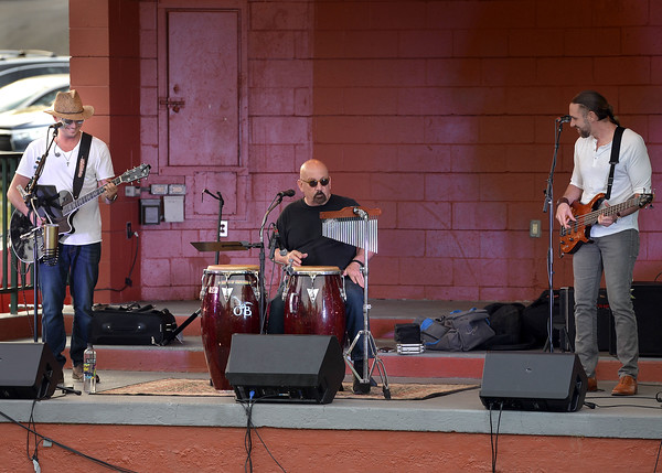 CARL RUSSO/Staff photo. The Josh Logan Trio; from left,  Josh on Guitar, Paul Costly on percussion and Nate Comb on bass opened the summer season of free concerts in Derry's MacGregor Park Tuesday night. 6/12/2018