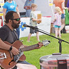 TIM JEAN/Staff photo<br /> <br /> Zak Trojano sings and plays his guitar during the Derry Homegrown Farm and Artisan Market in downtown Derry, NH.    6/2/21
