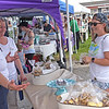 TIM JEAN/Staff photo<br /> <br /> Nelly Brown, right, of Derry, listens to Jo-Anne Dombrowskas, left, of Lush Confections as she talks about the cookies they bake during the Derry Homegrown Farm and Artisan Market in downtown Derry, NH.    6/2/21