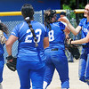 TIM JEAN/Staff photo<br /> <br /> Salem's starting pitcher, Madison Solt is congratulated by her teammates after defeating Londonderry 10-2 in the D1 Softball quarterfinal game.   6/5/21