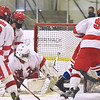 CARL RUSSO/staff photo Pinkerton's goalie Paul Lescovitz makes the save with help from his teammates. Pinkerton Academy defeated Londonderry high 7-4 in D1 tournament boys hockey action Wednesday afternoon.  3/03/2021