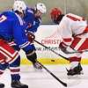 CARL RUSSO/staff photo Londonderry's Connor Paiton  and Matthew Boton, 7, battle for the puck with Pinkerton's Nick Plaza. Pinkerton Academy defeated Londonderry high 7-4 in D1 tournament boys hockey action Wednesday afternoon.  3/03/2021
