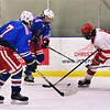 CARL RUSSO/staff photo Londonderry's Connor Paiton  and Matthew Boton, 7 battle for the puck with Pinkerton's Nick Plaza. Pinkerton Academy defeated Londonderry high 7-4 in D1 tournament boys hockey action Wednesday afternoon.  3/03/2021