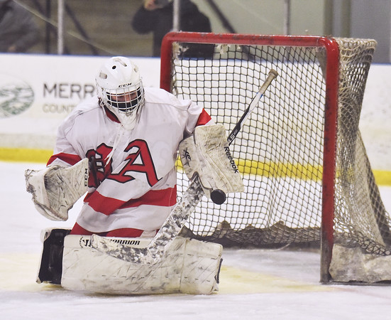 CARL RUSSO/staff photo Pinkerton's goalie Paul Lescovitz makes the save. Pinkerton Academy defeated Londonderry high 7-4 in D1 tournament boys hockey action Wednesday afternoon.  3/03/2021