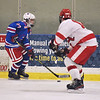 CARL RUSSO/staff photo Londonderry's Noah Malcolm            moves the puck against Pinkerton's Jon Caprigno. Pinkerton Academy defeated Londonderry high 7-4 in D1 tournament boys hockey action Wednesday afternoon.  3/03/2021