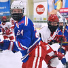 CARL RUSSO/staff photo Pinkerton's captain Hunter Drouin, right, and Londonderry' Matthew Palmer keep their eye on the puck as their teammates fight for it. Pinkerton Academy defeated Londonderry high 7-4 in D1 tournament boys hockey action Wednesday afternoon.  3/03/2021