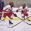 CARL RUSSO/staff photo Pinkerton's captain Hunter Drouin maneuvers the puck around Londonderry defender. Pinkerton Academy defeated Londonderry high 7-4 in D1 tournament boys hockey action Wednesday afternoon.  3/03/2021