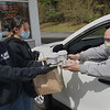 TIM JEAN/Staff photo<br /> <br /> At right, Phill Novick, of Windham, receives his pick-up order outside of Mary Ann's Diner from Rachel Anderson, left, and Kylee Andreoli, both of Windham. Windham teachers and support staff where treated to a free breakfast, courtesy of Mary Ann's Diner in Windham and KCL Homes, Custom Home Builders in Windham.    5/9/20
