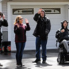 TIM JEAN/Staff photo<br /> <br /> From left to right, Ryan Kendall, 16, Jennifer Kendall, Nathan Miner, 24, and his brother Branden Miner, 26, all of Derry wave to vehicles as they pass them during a social distancing car parade of support for Branden, who was injured in a sledding accident earlier this year and returned home to Derry after rehab.     5/9/20