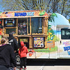 TIM JEAN/Staff photo<br /> <br /> Parents and children wait in line for a flavored shaved ice from the Kona Ice truck in the Food Truck Festival area on Manning St., during Derby Day in downtown Derry, NH.   5/1/21