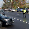 TIM JEAN/Staff photo<br /> <br /> Police officers direct traffic on Mammoth Road outside Londonderry High School on Election Day. Turnout was heavy in the morning then was steady throughout the day.  11/3/20