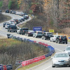 TIM JEAN/Staff photo<br /> <br /> Vehicles snake up the hill of London Bridge Road towards the High School on Election Day in Windham, NH. Turnout was heavy in the morning then was steady throughout the day. 11/3/20