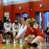 CARL RUSSO/Staff photo. Pinkerton's Liliy-Anne Heywood, left, and Reese Asselin double team to keep the ball in play. Pinkerton Academy  in volleyball action against Nashua South Thursday afternoon. 10/01/2020
