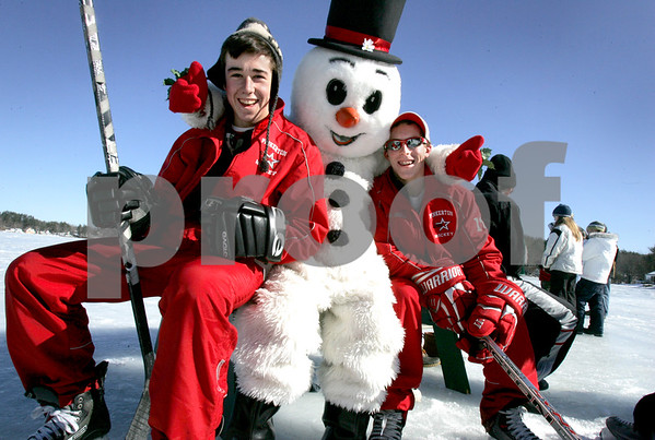 Derry: Pinkerton students, and volunteers helping out at the Frost Festival, from left, Teddy McCarran, 16, and Mark Kissel call Frosty over for a photo with him when they spot him from across the ice during Sunday's fun on Beaver Lake. Photo by Jan Seeger/Derry News Monday, February 16, 2009