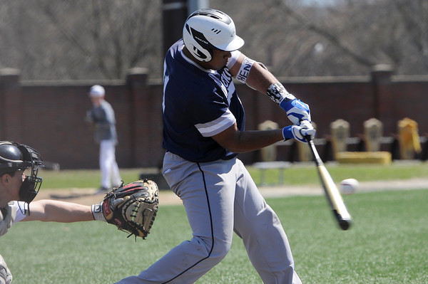 TIM JEAN/Staff photo  Lawrence's Henry Checo drives the ball for a hit against Haverhill during baseball action at Trinity Stadium in Haverhill. Lawrence won 8-3.     4/17/19