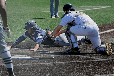 TIM JEAN/Staff photo  Lawrence's Angelo Rojas is tagged out by Haverhill catcher Mark Casto at home plate during baseball action at Trinity Stadium in Haverhill. Lawrence won 8-3.     4/17/19