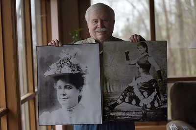 TIM JEAN/Staff photo  Jack Lynch, Hall of Fame Committee member holds photographs of Maggie Cline, who will be inducted into the Haverhill Citizens Hall of Fame. 4/20/19