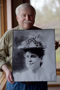 TIM JEAN/Staff photo  Jack Lynch, Hall of Fame Committee member holds a photograph of Maggie Cline, who will be inducted into the Haverhill Citizens Hall of Fame. 4/20/19