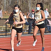 CARL RUSSO/staff photo Haverhill senior Elena Albano takes the baton from sophomore Emily Cruickshank in the  4 x 200 race.<br /> <br />  Methuen competed against Haverhill in boys and girls track at the Sapienza Memorial Track at Haverhill high.  4/07/2021