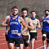 CARL RUSSO/staff photo Methuen junior Freddy Coleman maintains the lead in the mile with Haverhill senior Aidan Corcoran staying close behind. Coleman captured first place and Corcoran finished in third. Methuen junior Jason Dibble captured second place. <br /> <br /> Methuen competed against Haverhill in boys and girls track at the Sapienza Memorial Track at Haverhill high.  4/07/2021