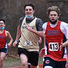 CARL RUSSO/staff photo Central senior Liam Awiszus and Haverhill senior Pat Kelleher sprint to the finish line in the 300 meter race. <br /> <br /> Central Catholic competed against Haverhill high in boys and girls track meet at Haverhill high. 3/31/2021
