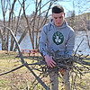 TIM JEAN/Staff photo<br />   <br /> James LeBlond, of Salem, NH., and formerly of Haverhill, stacks up tree branches and other debris at the Merrimack River Park on Route 110 during an Earth Day cleanup in Haverhill.   4/21/18