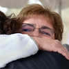 CARL RUSSO/Staff photo. GAZETTE:  Rep. Linda Dean Campbell, D-Methuen gets a tearful hug from Caitlin's mother, Mary Trask during the ceremony. An Army veteran, Campbell proposed the legislation to name the Haverhill bridge in honor of the late Navy petty officer last year. <br /> The Industrial Bridge on Ferry Road in Bradford was dedicated to U.S. Navy Petty Officer, Caitlin Trask of North Andover and Bradford Saturday morning. This is the first bridge in the country ever dedicated to a female service member. Caitlyn Trask, U.S. Navy Petty Officer Third Class, was just 20 years old when she was killed by her ex-boyfriend, a fellow sailor, at a military housing complex in Virginia in 2009. 4/14/2018