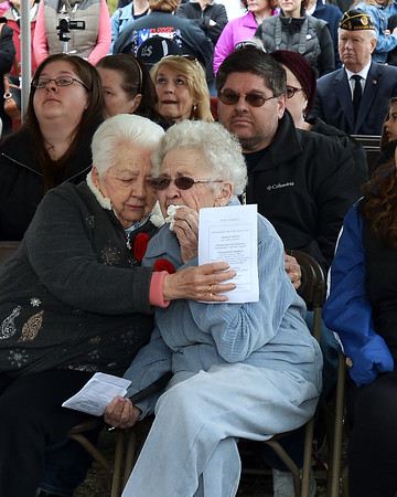 CARL RUSSO/Staff photo. Caitlin Trask's  grandmother, Arlene Trask of Beverly, right, and her great aunt, Phyllis Brillant of Londonderry become emotional during the ceremony. The Industrial Bridge on Ferry Road in Bradford was dedicated to U.S. Navy Petty Officer, Caitlin Trask of North Andover and Bradford Saturday morning. This is the first bridge in the country ever dedicated to a female service member.<br /> Caitlyn Trask, U.S. Navy Petty Officer Third Class, was just 20 years old when she was killed by her ex-boyfriend, a fellow sailor, at a military housing complex in Virginia in 2009. 4/14/2018