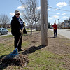 TIM JEAN/Staff photo<br />   <br /> Members of Haverhill Rotary Megan Shea, left, and David Shaw, both of Haverhill, rake up debris in the island along Lincoln Avenue during a Earth Day cleanup in Haverhill.     4/21/18
